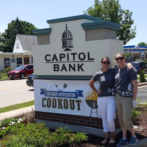 Vaness and Wendy by the Capitol Bank Verona Sign and Cookout Sign