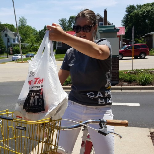 Vanessa loading her bike for a customer delivery at Capitol Bank Verona Cookout