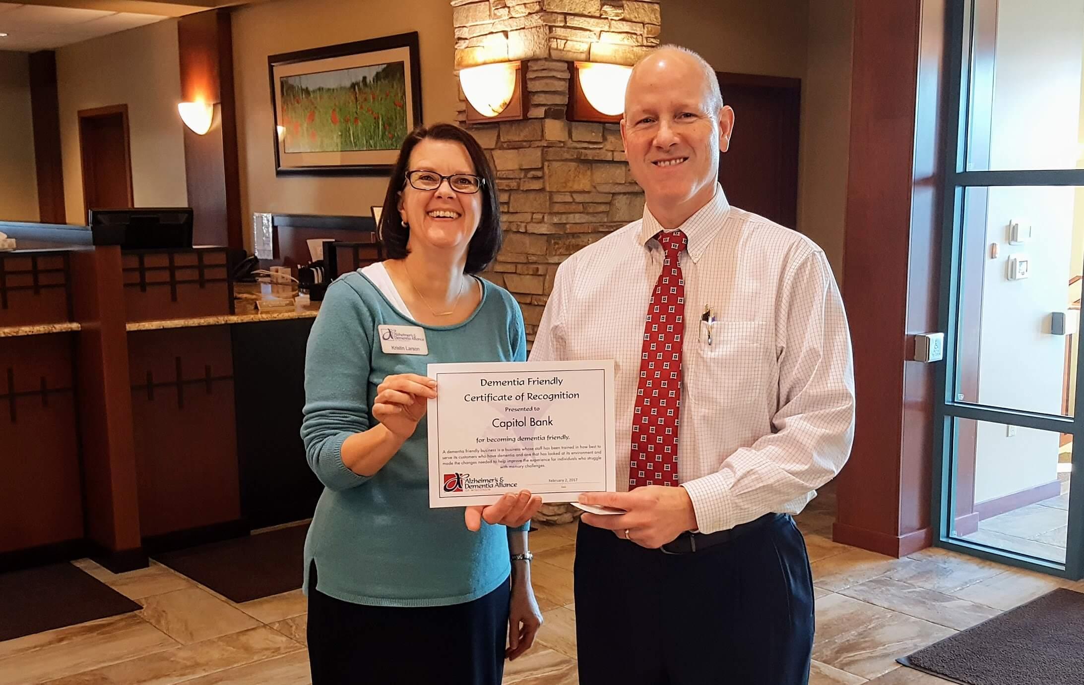 Ken Thompson receives dementia certification from Kristin Larson